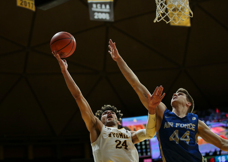 Wyoming guard Hunter Maldonado (24) attempts a shot as Air Force guard Keaton Van Soelen (44) stretches out a block as the University of Wyoming Mens Basketball hosts Air Force Academy, Wednesday, Dec. 4, 2019 in Arena-Auditorium. Nadav Soroker/Laramie Boomerang