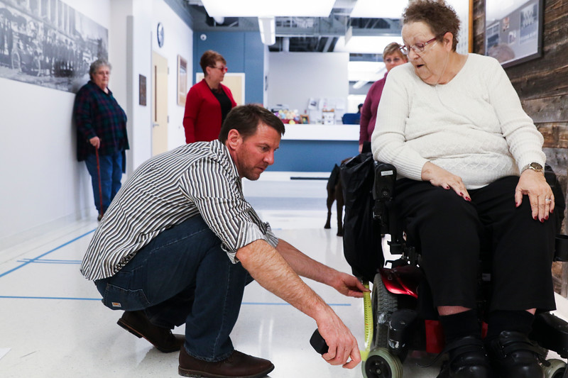 Ben Hornak, a representative for the city, measures the wheelchair of Mary Richey, a vice-chair of the Mayor's Council for People with Disabilities, as council members work with Hornak and the architect to test out the floor plan for the new Municipal Court Building, Friday, Dec. 6, 2019 at the Cheyenne Public Safety Center. After taping out the plan, the members voiced concerns on spacing and tried navigating the space so the architect and Hornak could see potential challenges. Nadav Soroker/Wyoming Tribune Eagle
