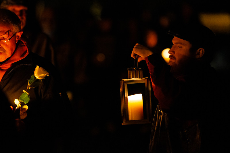 "Dylan Smith, right, holds a lantern in remembrance of his brother Shayne Smith, and helps people during the walk to the Christmas Box Angel to remember lost loved ones, Friday, Dec. 6, 2019 in Lakeview Cemetery. The event, inspired by the Richard Paul Evans novel ""The Christmas Box"" is a chance for people to remember children and other family members who have passed. Nadav Soroker/Wyoming Tribune Eagle"