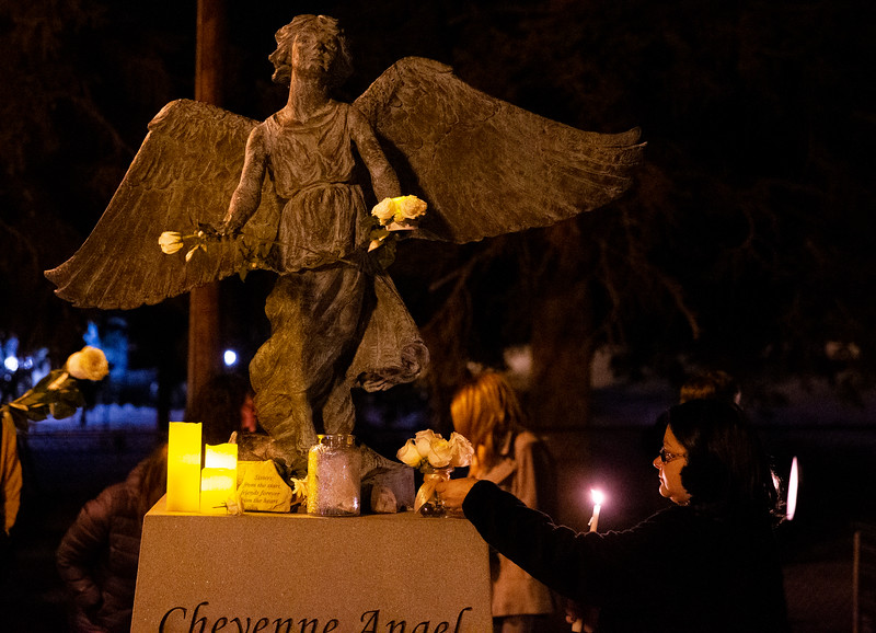 "Brittney Wells places white flowers at the feet of the Christmas Box Angel to remember lost loved ones, Friday, Dec. 6, 2019 in Lakeview Cemetery. The event, inspired by the Richard Paul Evans novel ""The Christmas Box"" is a chance for people to remember children and other family members who have passed. Nadav Soroker/Wyoming Tribune Eagle"