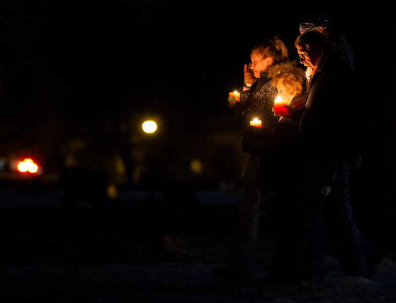 "A family carries white flowers and lit candles on the walk to the Christmas Box Angel to remember lost loved ones, Friday, Dec. 6, 2019 in Lakeview Cemetery. The event, inspired by the Richard Paul Evans novel ""The Christmas Box"" is a chance for people to remember children and other family members who have passed. Nadav Soroker/Wyoming Tribune Eagle"