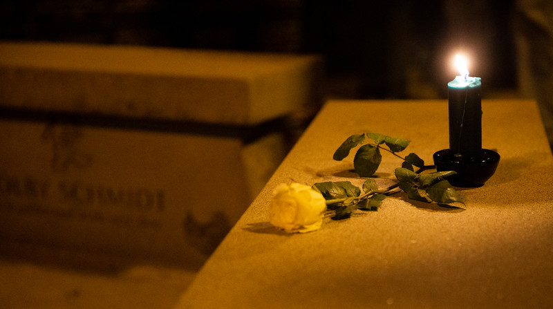 "A white flower and lit candle wait on a bench near the Christmas Box Angel during a vigil to remember lost loved ones, Friday, Dec. 6, 2019 in Lakeview Cemetery. The event, inspired by the Richard Paul Evans novel ""The Christmas Box"" is a chance for people to remember children and other family members who have passed. Nadav Soroker/Wyoming Tribune Eagle"