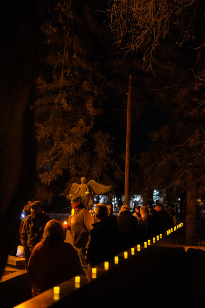 "Family members gather to remember lost loved ones during a candlelight vigil at the Christmas Box Angel, Friday, Dec. 6, 2019 in Lakeview Cemetery. The event, inspired by the Richard Paul Evans novel ""The Christmas Box"" is a chance for people to remember children and other family members who have passed. Nadav Soroker/Wyoming Tribune Eagle"