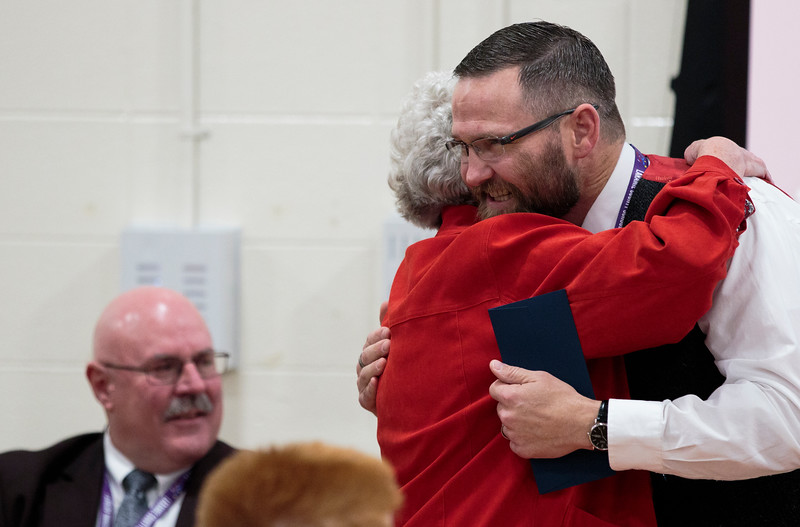 Principal Brian Cox, right, hugs Judy Lissman, a 1994 Milken Educators Award recipient, after being announced as the newest Milken Award recipient for Wyoming Monday, Dec. 9, 2019 at Johnson Junior High School. The Milken Award recognizes achievements by early- and mid-career educators while encouraging their future accomplishments with the $25,000 financial award. Nadav Soroker/Wyoming Tribune Eagle