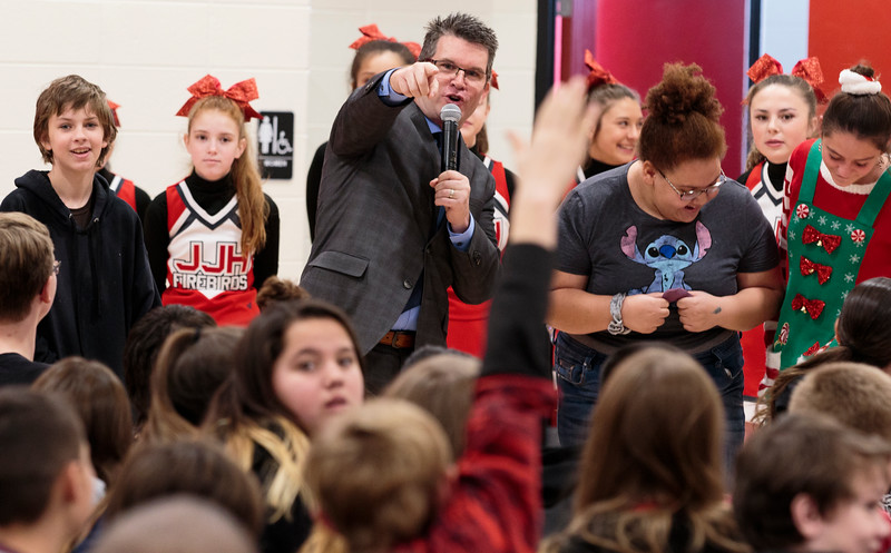 Greg Gallagher, the senior program director at the Milken Family Foundation, picks students to help him introduce Principal Brian Cox as the only 2019 Milken Educators Award for Wyoming Monday, Dec. 9, 2019 at Johnson Junior High School. The Milken Award recognizes achievements by early- and mid-career educators while encouraging their future accomplishments with an unrestricted $25,000 award. Nadav Soroker/Wyoming Tribune Eagle
