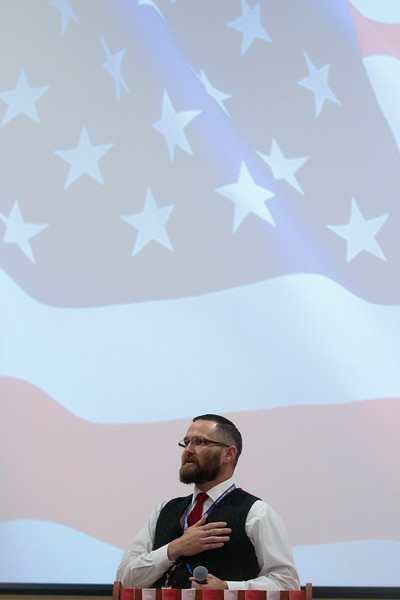 Johnson Junior High School Principal Brian Cox covers his heart during the pledge of allegiance during an assembly where he was surprised by the announcement that he is the only 2019 Milken Educators Award for Wyoming Monday, Dec. 9, 2019 at Johnson Junior High School. Cox was told that the assembly was for Wyoming Superintendent of Public Instruction Jillian Balow's discussion on Breakfast After the Bell. Nadav Soroker/Wyoming Tribune Eagle