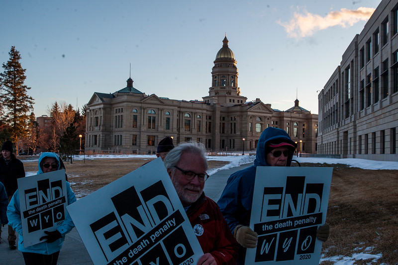 Rodger McDaniel and Bob Garrard carry signs during a march around the capitol in support of repealing the death penalty in Wyoming Monday, Dec. 9, 2019 in Cheyenne. About twenty other marchers in a circuit of the capitol before marching down Capitol Street. Nadav Soroker/Wyoming Tribune Eagle