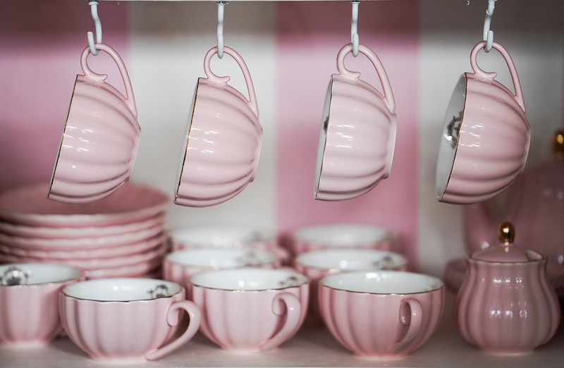 Teacups and other accouterments wait on a back cabinet, Wednesday, Dec. 11, 2019 at The Sugar Mouse. Ruth Williams opened The Sugar Mouse, a cupcakery which will donate the proceeds to help trafficking victims in Cambodia. Nadav Soroker/Laramie Boomerang