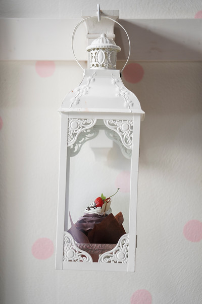 A cupcake in a lantern hangs on the wall, Wednesday, Dec. 11, 2019 at The Sugar Mouse. Ruth Williams opened The Sugar Mouse, a cupcakery which will donate the proceeds to help trafficking victims in Cambodia. Nadav Soroker/Laramie Boomerang