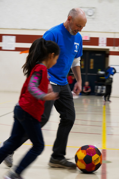 Tony Schaneman plays soccer with a student as he substitutes for PE Teacher Jesse Martin during a second grade class, Friday, Dec. 13, 2019 at Spring Creek Elementary. Schaneman is a student teacher from University of Wyoming, which is piloting a new student teaching program in cooperation with Albany County School District No. 1 next year. Nadav Soroker/Laramie Boomerang