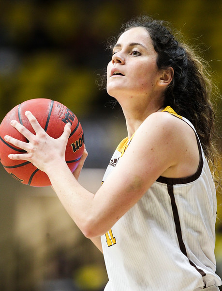 Wyoming guard Alba Sanchez Ramos (11) looks for an open teammate, Thursday, Dec. 12, 2019 at Arena-Auditorium. The Wyoming Cowgirls lead the Mississippi Valley Devilettes 52-9 at half-time. Nadav Soroker/Laramie Boomerang