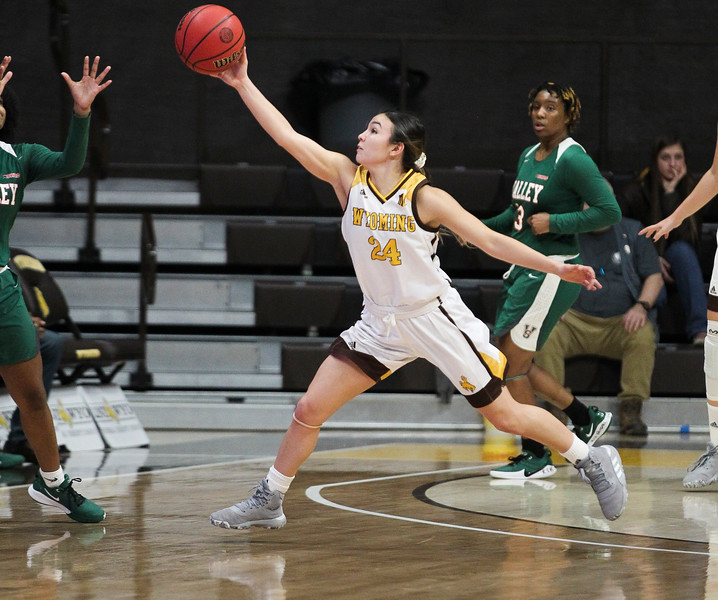 Wyoming guard Tommi Olson (24) redirects a Devilettes pass, Thursday, Dec. 12, 2019 at Arena-Auditorium. The Wyoming Cowgirls defeated the Mississippi Valley Devilettes 95-22. Nadav Soroker/Laramie Boomerang