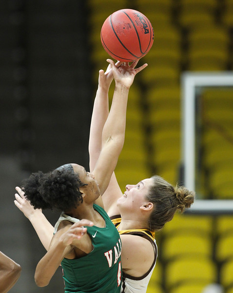 Wyoming forward Tereza Vitulova (2) fights for the tossup against Mississippi Valley's Shelli Thigpen (4), Thursday, Dec. 12, 2019 at Arena-Auditorium. The Wyoming Cowgirls lead the Mississippi Valley Devillettes 52-9 at half-time. Nadav Soroker/Laramie Boomerang