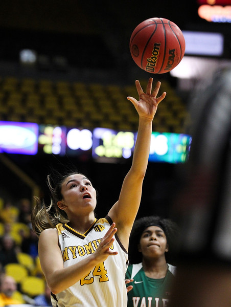Wyoming guard Tommi Olson (24) takes a shot, Thursday, Dec. 12, 2019 at Arena-Auditorium. The Wyoming Cowgirls defeated the Mississippi Valley Devilettes 95-22. Nadav Soroker/Laramie Boomerang