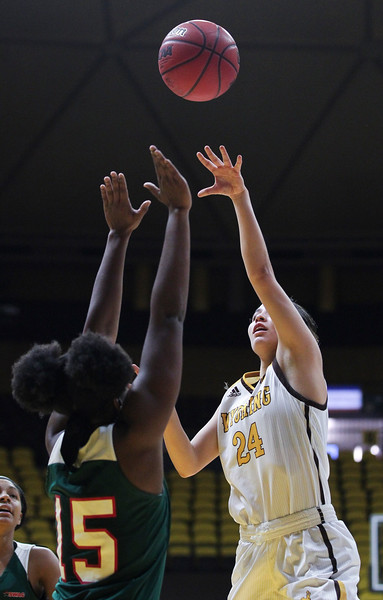 Wyoming guard Tommi Olson (24) takes a shot, Thursday, Dec. 12, 2019 at Arena-Auditorium. The Wyoming Cowgirls lead the Mississippi Valley Devilettes 52-9 at half-time. Nadav Soroker/Laramie Boomerang
