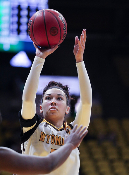 Wyoming forward Jaye Johnson (5) takes a shot, Thursday, Dec. 12, 2019 at Arena-Auditorium. The Wyoming Cowgirls lead the Mississippi Valley Devilettes 52-9 at half-time. Nadav Soroker/Laramie Boomerang