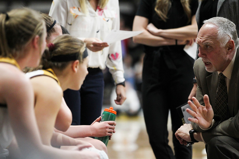 Wyoming coach Dave Pilipovich gives instructions during a timeout, Thursday, Dec. 12, 2019 at Arena-Auditorium. The Wyoming Cowgirls defeated the Mississippi Valley Devilettes 95-22. Nadav Soroker/Laramie Boomerang