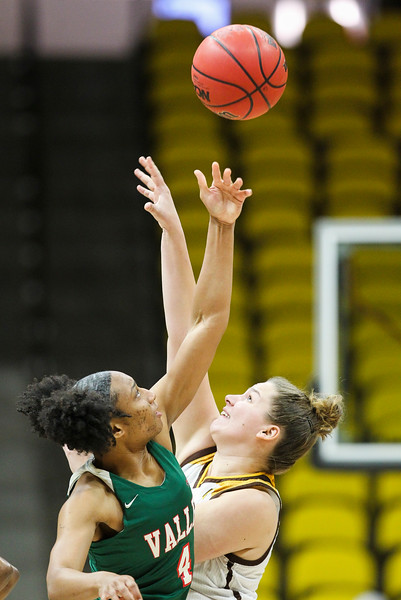 Wyoming forward Tereza Vitulova (2) fights for the tossup against Mississippi Valley's Shelli Thigpen (4), Thursday, Dec. 12, 2019 at Arena-Auditorium. The Wyoming Cowgirls lead the Mississippi Valley Devilettes 52-9 at half-time. Nadav Soroker/Laramie Boomerang