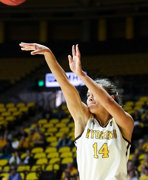 Wyoming guard Quinn Weidemann (14) shoots for a three, Thursday, Dec. 12, 2019 at Arena-Auditorium. The Wyoming Cowgirls lead the Mississippi Valley Devilettes 52-9 at half-time. Nadav Soroker/Laramie Boomerang