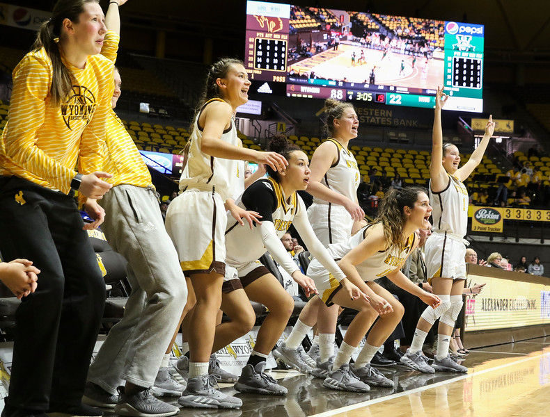 The Cowgirls Bech erupts after a three-pointer, Thursday, Dec. 12, 2019 at Arena-Auditorium. The Wyoming Cowgirls defeated the Mississippi Valley Devilettes 95-22. Nadav Soroker/Laramie Boomerang