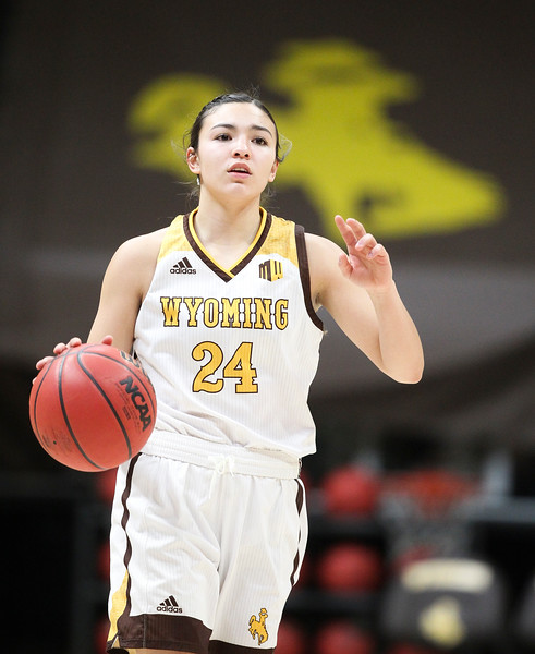 Wyoming guard Tommi Olson (24) looks for a teammate as she brings the ball up court, Thursday, Dec. 12, 2019 at Arena-Auditorium. The Wyoming Cowgirls lead the Mississippi Valley Devilettes 52-9 at half-time. Nadav Soroker/Laramie Boomerang