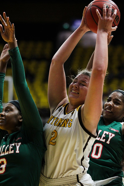 Wyoming forward Tereza Vitulova (2) fights Mississippi Valley center Azaria Howard (30) and Mississippi Valley's Diamond Wraggs (20) for a rebound, Thursday, Dec. 12, 2019 at Arena-Auditorium. The Wyoming Cowgirls defeated the Mississippi Valley Devilettes 95-22. Nadav Soroker/Laramie Boomerang