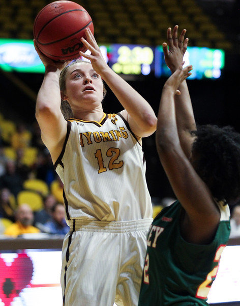 Wyoming guard McKinley Bradshaw (12) takes a shot, Thursday, Dec. 12, 2019 at Arena-Auditorium. The Wyoming Cowgirls defeated the Mississippi Valley Devilettes 95-22. Nadav Soroker/Laramie Boomerang