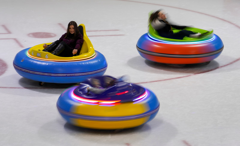 Airman First Class Sadie Evans, left, and other members and family of the 90th CPTS at F.E. Warren spin on the ice in bumper cars during a morale event, Friday, Dec. 13, 2019 at the Cheyenne Ice and Events Center. The trip to the ice rink preceded their division holiday party. Nadav Soroker/Wyoming Tribune Eagle