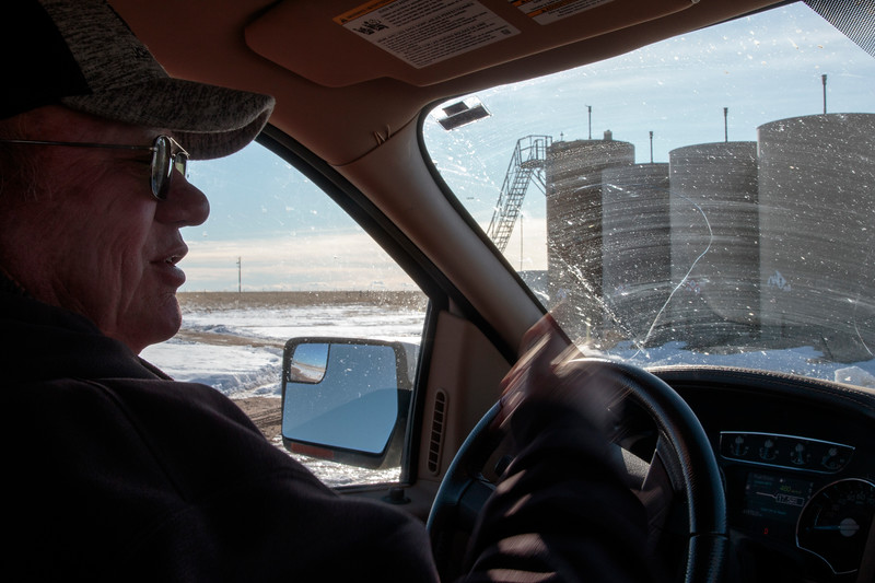 Owen Goertz drives past a disposal well for water from nearby oil rigs, which could instead have its water cleaned and used to irrigate the nearby field, Friday, Dec. 13, 2019 near Hillsdale. The reclaimed water irrigation would allow Goertz to potentially double some of his hay production compared to the dry land production he has now. Nadav Soroker/Wyoming Tribune Eagle