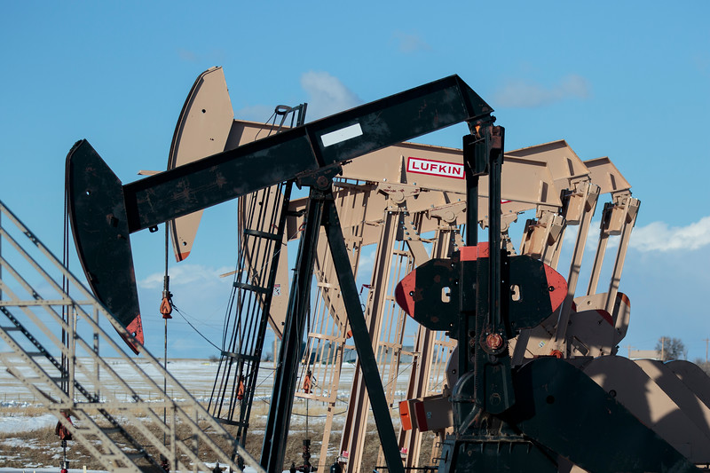 Oil rigs on a new drilling pad would provide water to be decontaminated and used for irrigation by Owen Goertz, a pilot rancher for a new oil water reclamation program, Friday, Dec. 13, 2019 near Hillsdale. The reclaimed water irrigation would allow Goertz to potentially double some of his hay production compared to the dry land production he has now. Nadav Soroker/Wyoming Tribune Eagle