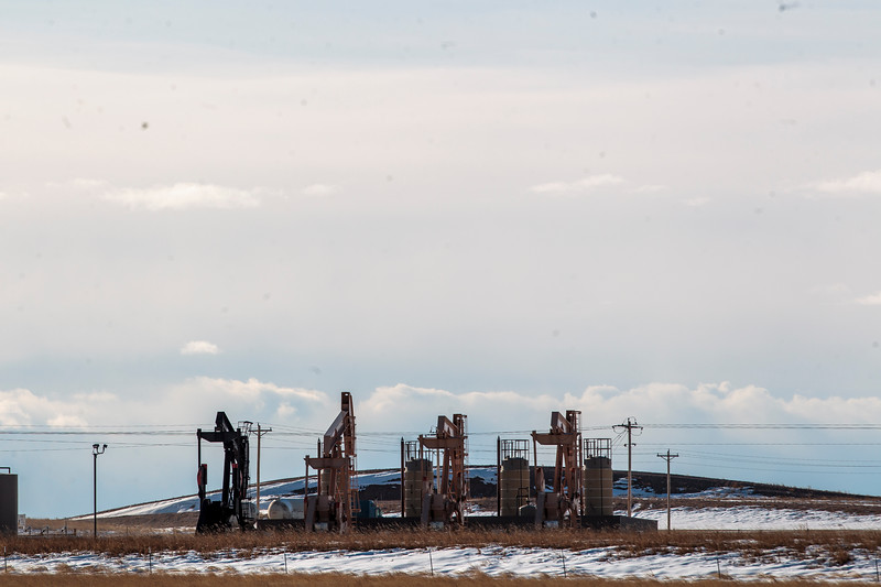 Oil rigs on a new drilling pad would provide water to be decontaminated and used for irrigation by Owen Goertz, a pilot rancher for a new oil water reclamation program, Friday, Dec. 13, 2019 near Hillsdale. Nadav Soroker/Wyoming Tribune Eagle