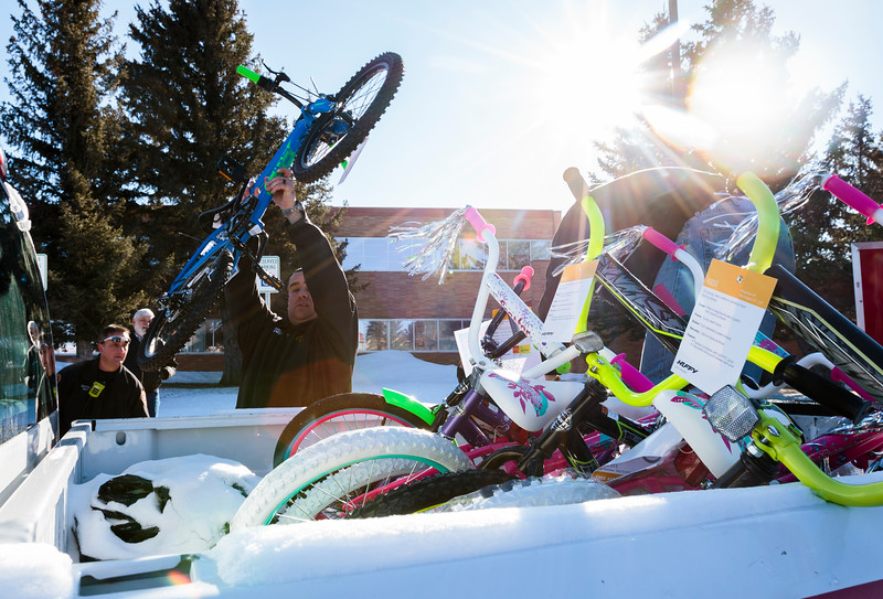 Cheyenne firefighters load bikes donated by WYDOT employees into a trailer for the annual Bicycle Drive Monday, Dec. 16, 2019 at WYDOT headquarters. Nadav Soroker/Wyoming Tribune Eagle
