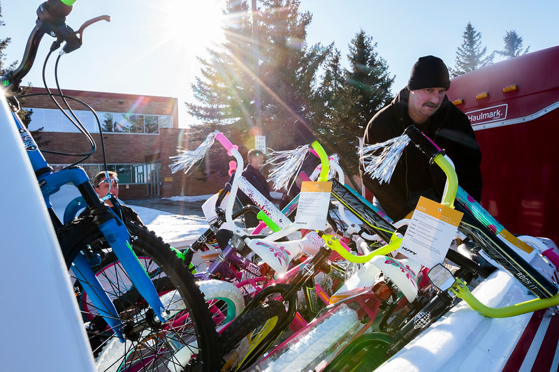 Cheyenne firefighter Robert Kreps loads a bike donated by WYDOT employees into a truck for the annual Bicycle Drive Monday, Dec. 16, 2019 at WYDOT headquarters. The bike drive is run by the Firefighters Local 279 Union in partnership with the school district, WYDOT and other community members to give bikes to kids who wouldn't otherwise receive them. Nadav Soroker/Wyoming Tribune Eagle
