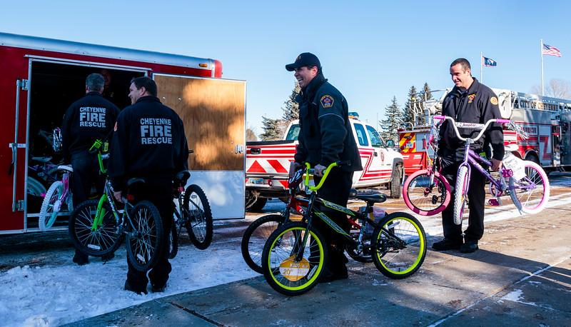 Cheyenne firefighters Andrew Dyl, left, Vince McQueeney and Brad Hall load bikes donated by WYDOT employees into a trailer for the annual Bicycle Drive Monday, Dec. 16, 2019 at WYDOT headquarters. The bike drive is run by the Firefighters Local 279 Union in partnership with the school district, WYDOT and other community members to give bikes to kids who wouldn't otherwise receive them. Nadav Soroker/Wyoming Tribune Eagle