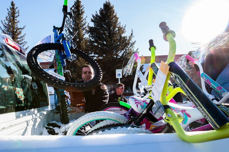 Cheyenne firefighter Brad Hall loads a bike donated by WYDOT employees into a truck for the annual Bicycle Drive Monday, Dec. 16, 2019 at WYDOT headquarters. The bike drive is run by the Firefighters Local 279 Union in partnership with the school district, WYDOT and other community members to give bikes to kids who wouldn't otherwise receive them. Nadav Soroker/Wyoming Tribune Eagle