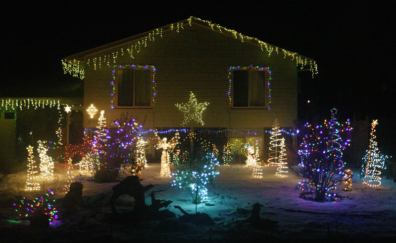 A decorated house passes by as Sue James takes guests on a tour of holiday lights Tuesday, Dec. 17, 2019 in North Cheyenne. Nadav Soroker/Wyoming Tribune Eagle
