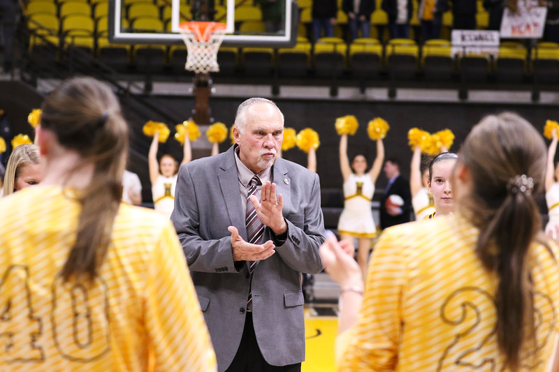 Cowgirls head coach Gerald Mattinson claps along to the marching band after the end of the game Tuesday, Dec. 17, 2019 at Arena-Auditorium. Laramie Women's Basketball lose to Gonzaga 54-65. Nadav Soroker/Laramie Boomerang