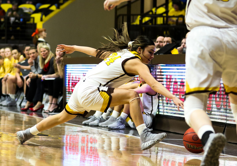 Wyoming guard Tommi Olson (24) dives for the ball after it nearly bounces out of the court Tuesday, Dec. 17, 2019 at Arena-Auditorium. Laramie Women's Basketball hosts Gonzaga. Nadav Soroker/Laramie Boomerang