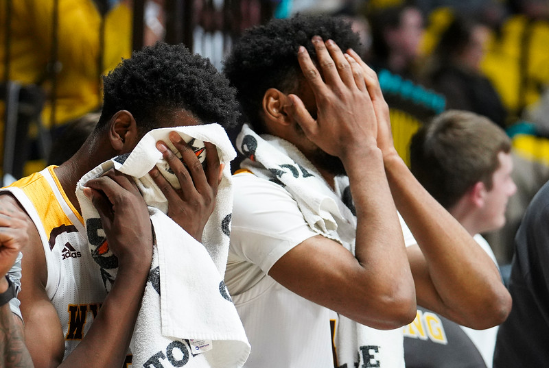 Wyoming players cover their faces after a penalty is called Thursday, Dec. 19, 2019 at Arena-Auditorium. The Wyoming Cowboys lose to the Utah Valley Wolverines 67-69. Nadav Soroker/Laramie Boomerang