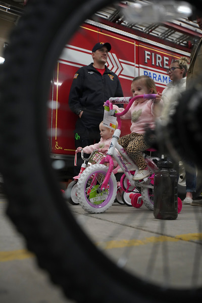 Josie Coonts, 1, front, and Finley Coonts, 1, test out their new bikes at the Local 279 Firefighters' third annual bike drive Friday, Dec. 20, 2019 at Cheyenne Fire Rescue Station 1. The firefighters collected about 100 bikes to give away to kids. Nadav Soroker/Wyoming Tribune Eagle