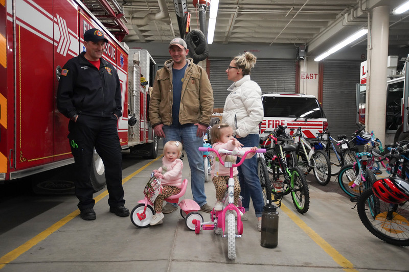 Cheyenne Fire Rescue firefighters give bikes to children during the third annual bike drive Saturday, Dec. 21, 2019 at Cheyenne Fire Rescue Station 1. Nadav Soroker/Wyoming Tribune Eagle