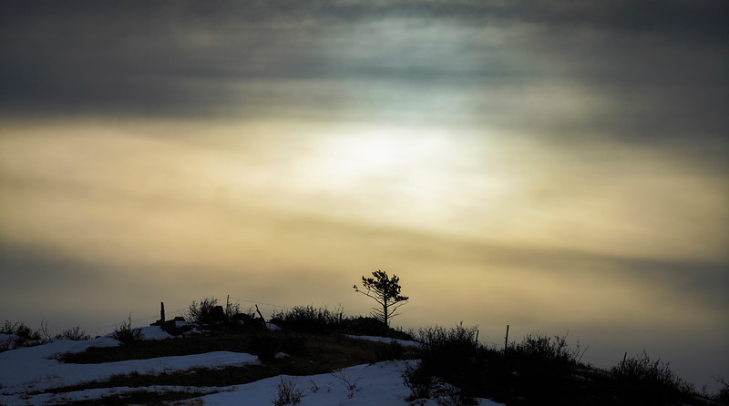 The sun sets through low cloud cover Monday, Dec. 23, 2019 near Pine Grove. The National Weather Service predicts mild temperatures varying from mostly sunny to partly cloudy through the end of the week. Nadav Soroker/Wyoming Tribune Eagle