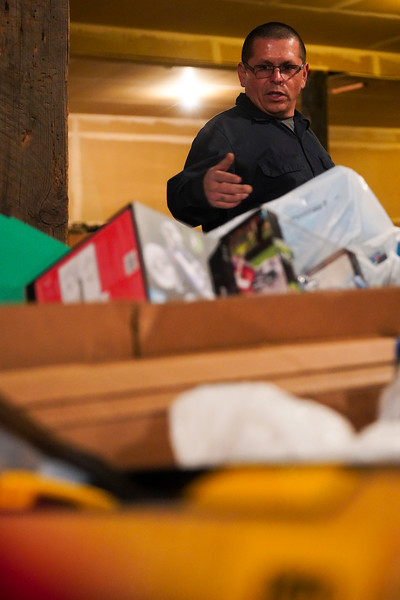 Ruben Castaneda shows off the four large bins of toys he has raised to give away to kids for Christmas Monday, Dec. 23, 2019 at Ruben's Metals. Castaneda is continuing a tradition that his father, also Ruben, started. Nadav Soroker/Wyoming Tribune Eagle