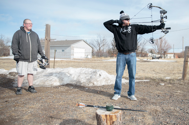 Travis, left, watches Dustin Steele practice his archery skills Thursday, Dec. 26, 2019 at the Cheyenne Field Archers outdoor range. The Steele brothers were at the range to practice and tune the bow that Travis received for Christmas. Nadav Soroker/Wyoming Tribune Eagle