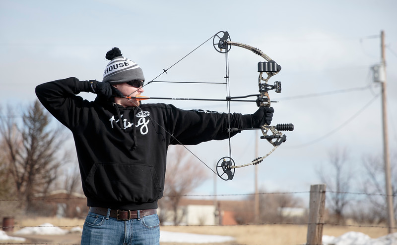 Dustin Steele practices his skills Thursday, Dec. 26, 2019 at the Cheyenne Field Archers outdoor range. Steele was at the range with his brother, Travis Steele, as they tuned the bow Travis received for Christmas. Nadav Soroker/Wyoming Tribune Eagle