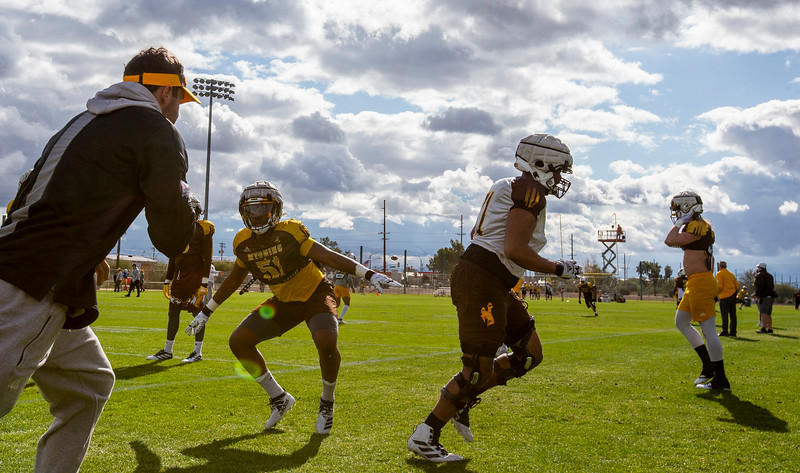 Wyoming defensive end Solomon Byrd (51), center left, runs drills as the University of Wyoming football team practices at the FC Tuscon Saturday, Dec. 28, 2019 in Tucson. The Cowboys will take on the Georgia State Panthers on New Years Eve, at Arizona Stadium. Nadav Soroker/Wyoming Tribune Eagle