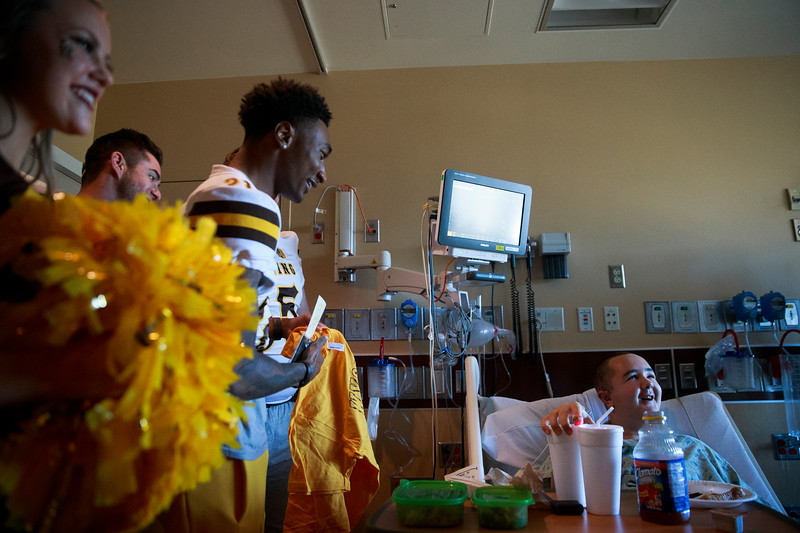 Desmond, 14, chats with members of the Wyoming Cowboys and cheer team in his room Sunday, Dec. 29, 2019 at the Diamond Childrens Hospital in Tucson. Members of the Wyoming Cowboys and Georgia State Panthers visited children at the hospital before their game in the Arizona Bowl. Nadav Soroker/Wyoming Tribune Eagle