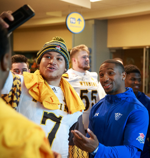 Wyoming running back Trey Smith takes a selfie with Georgia State cornerback Ben Hood after visiting with the kids Sunday, Dec. 29, 2019 at the Diamond Childrens Hospital in Tucson. Members of the Wyoming Cowboys and Georgia State Panthers visited children at the hospital before their game in the Arizona Bowl. Nadav Soroker/Wyoming Tribune Eagle