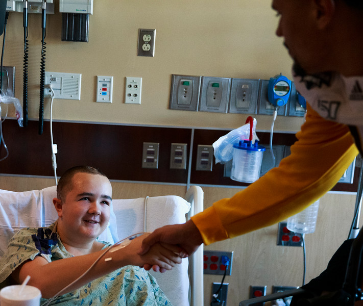 Desmond, 14, shakes hands with Wyoming quarterback Sean Chambers in his room Sunday, Dec. 29, 2019 at the Diamond Childrens Hospital in Tucson. Members of the Wyoming Cowboys and Georgia State Panthers visited children at the hospital before their game in the Arizona Bowl. Nadav Soroker/Wyoming Tribune Eagle