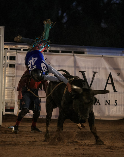 A cowboy wearing a Georgia State Panthers jersey is thrown from the back of a bull Sunday, Dec. 29, 2019 at Old Tucson in Tucson. Old Tucson, a movie studio and theme park hosts teams for rodeo, dinner and a show before the Arizona bowl. Nadav Soroker/Wyoming Tribune Eagle